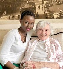 caregiver sitting with elder