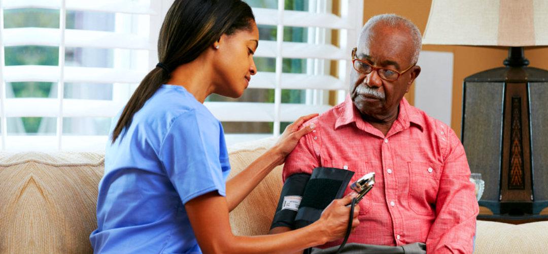 caregiver measuring blood pressure
