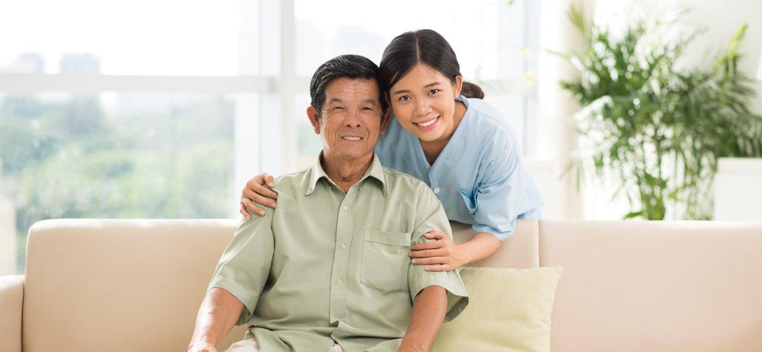 senior man smiling with his caregiver